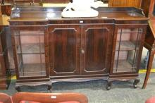 Early 20th Century Mahogany Breakfront Display Cabinet, with two central timber doors and astragal corner section on carved ball and...
