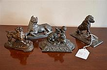 A Collection of Four Antique French Metal Dog Statues -
