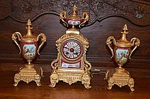19th Century French gilt and porcelain hand painted clock; garniture, key and pendulum, made by Marti
