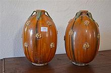 PAIR CHINESE SANCAI GLAZED EXCAVATED TANG WINE EWERS of melon shape, body covered with fine crackled straw coloured glaze