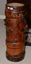 A Vintage English Leather artillery shell carrier with Royal Crest.