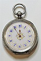 A LADY'S OPEN FACE SILVER POCKET WATCH; white dial with blue Arabic numerals, gold hands in a finely engraved 935 silver case. Diam....