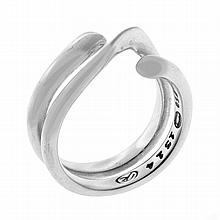 A GEORG JENSEN 18CT WHITE GOLD MAGIC RING; designed by Regitze Overgaard, in pouch. Size M. Wt. 9.7g.