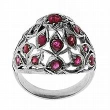A SILVER RUBY PRINCESS RING; one ruby missing. Size K.