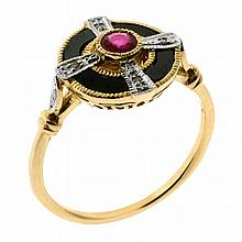 AN ART DECO STYLE GEM SET TARGET RING; centring a ruby, onyx sections and 6 round brilliant cut diamonds in 9ct gold. Size N - O)