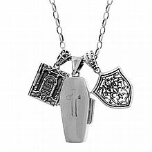 A STERLING SILVER PENDANT NECKLACE; attached with a fob, bible locket and a departure casket.