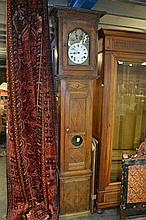 19th Century French Provincial Oak Comptoise with pierced brass and enamel dial signed Saunier a Bolbec