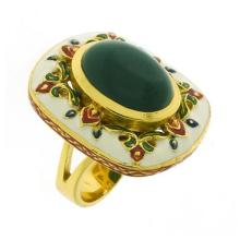 A SILVER GILT ENAMEL AND STONE SET RING; oval agate cabochon surrounded by enamel decoration, size O.