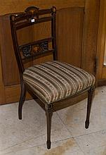 An Edwardian occasional chair. The top rail and splat inlaid with comports of fruit. Upholstered in Regency stripe. C. Late 1800's....