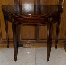 A Georgian revival inlaid and cross banded half round tea table. The folding top opening onto double gate legs. C. . H:760 x W:880 x...