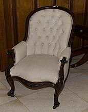 A substantial English carved Mahogany framed arm chair on castors upholstered in cream water mark fabric. C. Mid 1800's