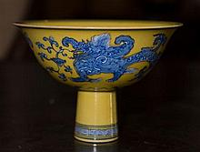 FINE CHINESE ENAMELLED YELLOW GROUND 'CHIMERA' STEM CUP,  decorated in underglaze blue  with Chimeras and lotus blossoms to the ex...