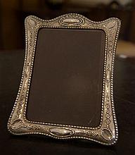A large Sterling Silver photo frame with floral garland decoration; 190mm x 240mm