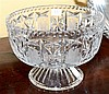 A LARGE LEAD CRYSTAL FOOTED BOWL WITH HAND ETCHED FLORAL PANELS