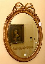 FRENCH OVAL SHAPED GILT MIRROR W/ BOW DESIGN