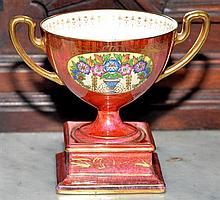 A MINTON BONE CHINA ART DECO LUSTRE GLAZE LOVING CUP DECORATED WITH FLORAL URNS & GILT HIGHLIGHTS