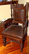 A PAIR OF ANTIQUE WELL CARVED OAK HALL ARMCHAIRS WITH PADDED BACK & SEAT RAISED ON FRONT VASE