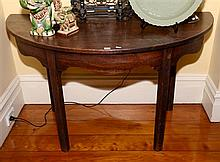 A PAIR OF ANTIQUE GEORGE III MAHOGANY DEMI-LUNE SIDE TABLED ON CHAMPHERED LEGS.