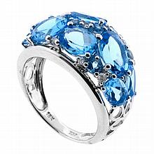 A HALF HOOP DIAMOND & GEM SET RING; set with seven round and seven oval cut blue topaz and eight round brilliant cut diamonds in 18c...