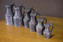 Set of six graduated pewter tankards