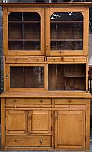 An English Mahogany Vintage Georgian style Breakfront 4 door Bookcase with a central Bureau flanked by 4 drawers.
