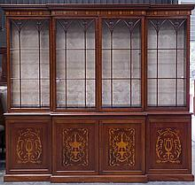 A large Mahogany Vintage 2 part Breakfront 4 door Bookcase. The lower doors decorated with Lyre and Foliate panels