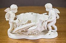 An Antique Moore Brothers Putti figured table centre piece. C. 1880