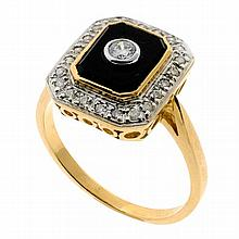 AN ART DECO STYLE ONYX AND DIAMOND RING; bezel set round brilliant cut diamond on an onyx plaque surrounded by a further 22 diamonds...