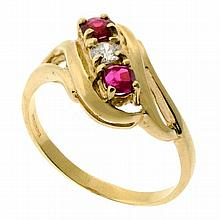 A 9CT GOLD RUBY AND DIAMOND RING; approx. 0.10ct round brilliant cut diamond flanked by 2 round cut rubies. Size P. Wt. 2.7g.