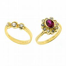 TWO 18CT GOLD RINGS; a red and white stone cluster, other set with 3 white stones. Wt. 7.9g.
