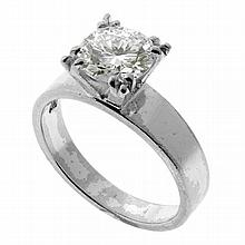 A PLATINUM SOLITAIRE DIAMOND RING; claw set with a round brilliant cut estimated in the setting as1.65ct,  H/I - VS. Size P. Wt. 5.6g.
