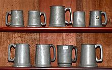Collection of nine pewter mugs.