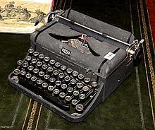 A Royal typewriter with case.