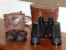 Two pairs of binoculars in leather cases. The aeroclub and Berkeley super Marine.