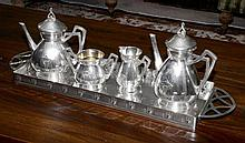 A William Macintosh inspired Arts & Crafts silver plate tea & coffee service including a long rectangular tray. C: 1890