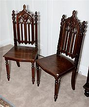 A pair of antique French Gothic oak side chairs