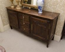 Antique 19th century French Rustic oak Louis XV style enfilade, fitted with a bank of three drawers flanked by two doors