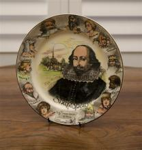 A Royal Doulton Shakespeare cabinet plate, the border with portraits of principle characters, C: 1938. D: 26cm