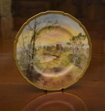 A Royal Doulton bone china cabinet plate painted with a named view, Inverlochy Castle, signed lower right, dated 1922. D: 26cm