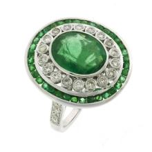 18ct White Gold Art Deco Style Emerald and Diamond Cluster Ring; Oval cut Emerald total 3.83ct, 28 Diamonds totalling 0.62ct, 28 cha...