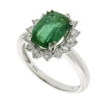 An 18ct White Gold Emerald and Diamond Cluster Ring; Emerald 2.88ct (est. whilst set), 14 round brilliant cut diamonds totalling 0.4...