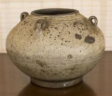 A four handled archaic style Asian pot, H 13cm, damage to one handle