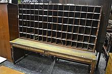Post office sorting table with pigeon holes