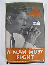 A Man Must Fight by Gene Tunney, first editon 1932. Inscribed by Tunny 1952 with a separated letter to J Roberts regarding The Darcy...