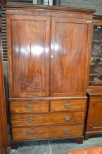George III Mahogany Press on Chest, the upper doors enclosing hanging space, with four drawers below. Width 127cm (Key In Office)
