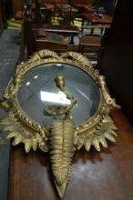 Late Victorian Gilt Oval Wall Mirror with Sconces and applied Fern Leaves.