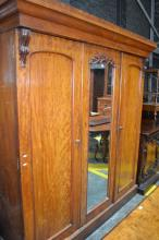 19th Century Cedar & Rose Mahogany Veneered Lenehan Wardrobe, with central mirror and two arched panel doors, enclosing slides & dra...