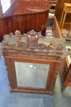 C19th Italian carved Walnut Cabinet with Putti and Armorial Crest above a mirrored door. Width 76cm (Key In Office)