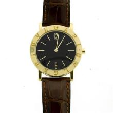 A BULGARI 18CT GOLD WRISTWATCH; ref; BB 33 GL with black dial, Arabic and baton markers on an 8 jewell quartz movement 732 MBBA, to...