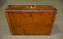 A Vintage well fitted Leather Suitcase